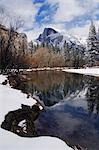 USA,California,Yosemite National Park. A reflection of Half Dome peak in the Merced River after fresh snow fall in Yosemite Valley. Stock Photo - Premium Rights-Managed, Artist: AWL Images, Code: 862-03437441