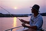 Zambia,Lower Zambezi National Park. Fly-fishing for tiger fish on the Zambezi River. Stock Photo - Premium Rights-Managed, Artist: AWL Images, Code: 862-03438043