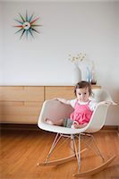 Baby Girl Sitting in a Rocking Chair Stock Photo - Premium Rights-Managednull, Code: 700-03439472