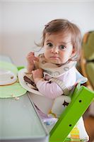 Baby Girl in Her High Chair Having Dinner Stock Photo - Premium Rights-Managednull, Code: 700-03439477