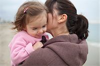 Close-up of Mother Holding Young Daughter in Arms, Long Beach, California, USA Stock Photo - Premium Rights-Managednull, Code: 700-03439541