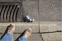 Broken Cell Phone and Feet Stock Photo - Premium Rights-Managednull, Code: 700-03439591