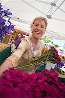 Woman Shopping For Flowers at a Farmer's Market, Santa Cruz, California, USA Stock Photo - Premium Rights-Managednull, Code: 700-03439957