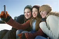 Three girls take self portrait with camera phone Stock Photo - Premium Royalty-Freenull, Code: 693-03440928