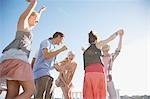 Friends dancing on rooftop Stock Photo - Premium Royalty-Freenull, Code: 635-03441023