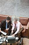 Businessmen using laptop in lobby Stock Photo - Premium Royalty-Freenull, Code: 635-03441222