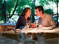 Couple holding hands at restaurant table Stock Photo - Premium Royalty-Freenull, Code: 635-03441299