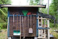 Gardening tools hung on side of shed Stock Photo - Premium Royalty-Freenull, Code: 633-03444801