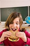 Girl Eating Lunch in School