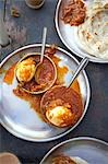 Hard Boiled Eggs With Masala and Paratha Bread, Kochi, Kerala, India Stock Photo - Premium Royalty-Free, Artist: Edward Pond, Code: 600-03445309