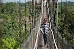 Boy on Footbridge, Sacha Lodge, Quito, Ecuador Stock Photo - Premium Rights-Managed, Artist: Mark Downey, Code: 700-03445677