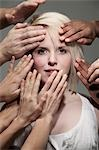 Woman being touched by many hands Stock Photo - Premium Royalty-Free, Artist: Harald Vorsteher, Code: 649-03447555