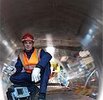 Engineer In Tunnel Of Forged Steel Stock Photo - Premium Royalty-Free, Artist: Blend Images, Code: 649-03448415