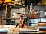 Engineer With Finished Steel Rollers Stock Photo - Premium Royalty-Free, Artist: Blend Images, Code: 649-03448441