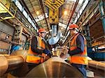 Engineer & Apprentice With Steel Rollers Stock Photo - Premium Royalty-Free, Artist: Science Faction, Code: 649-03448442