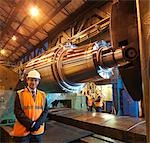 Engineers With Forged Steel Roller Stock Photo - Premium Royalty-Free, Artist: Blend Images, Code: 649-03448465