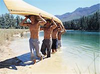 Group of Men Carrying a Canoe Stock Photo - Premium Rights-Managednull, Code: 700-03448764