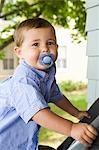 Boy with Pacifier in Mouth Stock Photo - Premium Rights-Managed, Artist: John Ferrentino, Code: 700-03451276