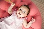 Baby Girl Lying on Ottoman Stock Photo - Premium Rights-Managed, Artist: John Ferrentino, Code: 700-03451280