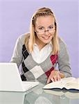 Young Woman Using Laptop Computer Stock Photo - Premium Royalty-Free, Artist: KL Services, Code: 600-03451510