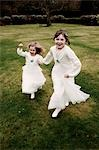 Two Flowergirls Running in Field Stock Photo - Premium Rights-Managed, Artist: Michael Clement, Code: 700-03451639