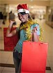 Young woman shopping with Christmas hat, KwaZulu Natal Province, South Africa Stock Photo - Premium Royalty-Freenull, Code: 682-03451840