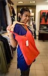 Woman trying on clothes at mall, KwaZulu Natal Province, South Africa