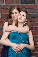 Teenage Girl Hugging Her Friend Stock Photo - Premium Rights-Managednull, Code: 700-03454518