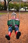 Girl in Swing, Portland, Oregon, USA Stock Photo - Premium Rights-Managed, Artist: Ty Milford, Code: 700-03455586