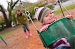 Girl in Swing, Portland, Oregon, USA Stock Photo - Premium Rights-Managed, Artist: Ty Milford, Code: 700-03455587