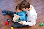 Boy Reading to Younger Brother Stock Photo - Premium Royalty-Free, Artist: KL Services, Code: 600-03456210