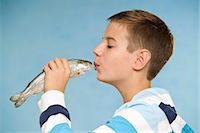 preteen kissing - Boy Kissing Fish Stock Photo - Premium Royalty-Freenull, Code: 600-03456221