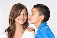 preteen kissing - Girl and Boy Kissing Stock Photo - Premium Royalty-Freenull, Code: 600-03456254