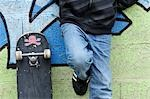 Boy with Skateboard Leaning Against Wall Stock Photo - Premium Rights-Managed, Artist: Jean-Christophe Riou, Code: 700-03456361
