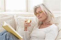 Woman Reading and Enjoying Glass of Wine Stock Photo - Premium Rights-Managednull, Code: 700-03456364
