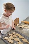 Little Girl Baking Christmas Cookies Stock Photo - Premium Royalty-Free, Artist: Shannon Mendes, Code: 600-03456683