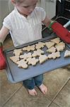 Little Girl Baking Christmas Cookies Stock Photo - Premium Royalty-Free, Artist: Shannon Mendes, Code: 600-03456693