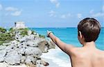 Boy Pointing at Temple, Tulum, Mexico Stock Photo - Premium Rights-Managed, Artist: KL Services, Code: 700-03456780