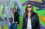 Two Girls Hanging Out near Graffiti Wall Stock Photo - Premium Rights-Managed, Artist: KL Services, Code: 700-03456793
