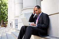 Businessman Using Laptop Outdoors Stock Photo - Premium Rights-Managednull, Code: 700-03456963