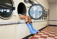 Man Lying in Clothes Dryer in Laundromat Stock Photo - Premium Rights-Managednull, Code: 700-03456964