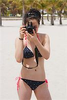 Teenage Girl on Beach wearing Bikini and taking Picture with Camera, Crandon Park Beach, Key Biscayne, Miami, Florida, USA Stock Photo - Premium Rights-Managednull, Code: 700-03456979