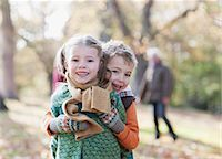 Brother and sister hugging outdoors Stock Photo - Premium Royalty-Freenull, Code: 635-03457360
