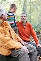 Grandfather, father and son laughing outdoors Stock Photo - Premium Royalty-Freenull, Code: 635-03457377