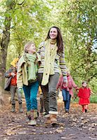 Family walking in park in autumn Stock Photo - Premium Royalty-Freenull, Code: 635-03457426