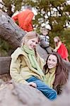 Mother and daughter sitting on tree branch Stock Photo - Premium Royalty-Freenull, Code: 635-03457428