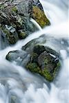 Close up of blurred water rushing in stream Stock Photo - Premium Royalty-Freenull, Code: 635-03457648