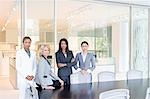 Businesswomen standing in office conference room Stock Photo - Premium Royalty-Freenull, Code: 635-03457796