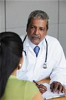 Indian doctor talking to patient Stock Photo - Premium Royalty-Freenull, Code: 655-03457963