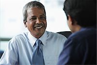 Two businessmen smiling at each other Stock Photo - Premium Royalty-Freenull, Code: 655-03458001